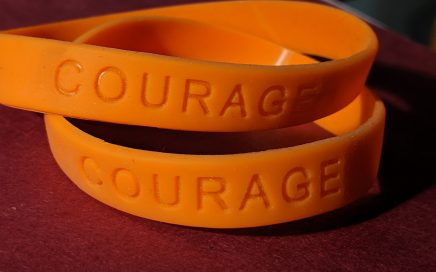 "Orange ""Courage"" silicone message bands. Photo by Jennifer Willis, 2019."