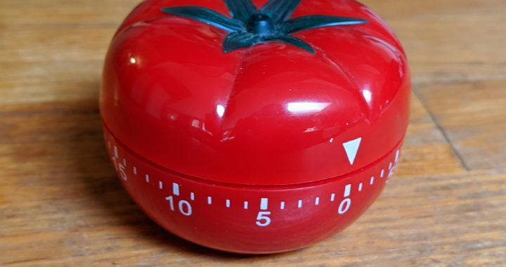 A tomato kitchen timer.